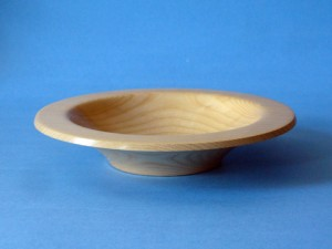 An Ash Bowl With A Flanged Rim