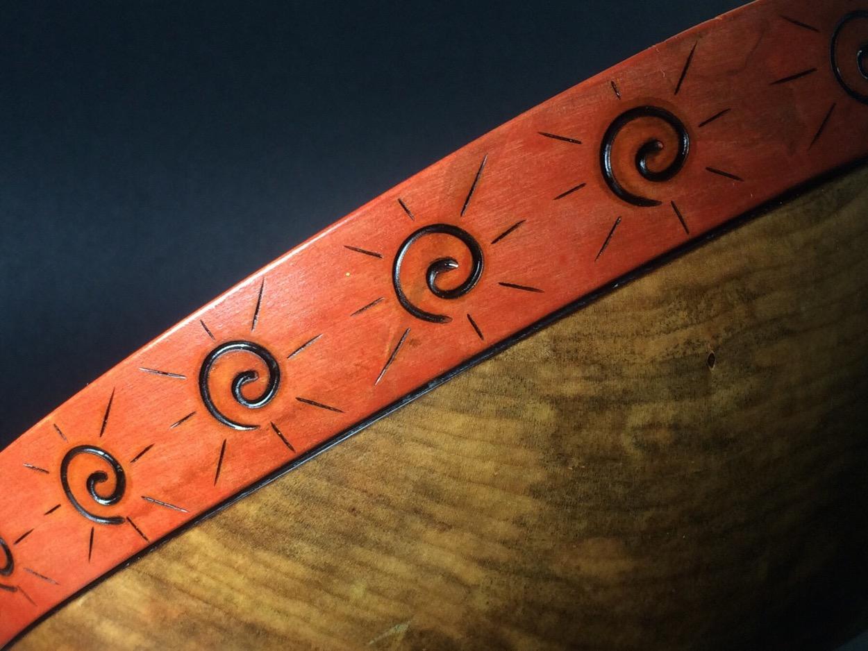 sun motif pyrography closeup